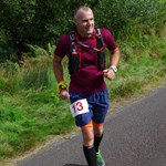 Ochils Leg 4 runner eyeing up the oceans on bracken on Leg 4.JPG